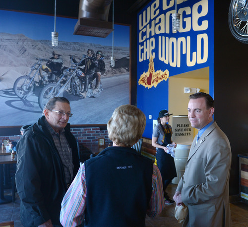 Steve Griffin  |  The Salt Lake Tribune   West Valley City councilman Don Christensen, left, and West Valley Mayor Mike Winder talk with people during a ribbon cutting ceremony for Freebirds World Burrito, in West Valley City, Utah Monday, December 9, 2013.