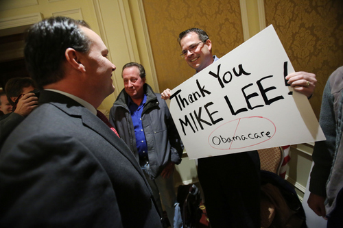 Francisco Kjolseth  |  The Salt Lake Tribune Jared Carman of Highland, Utah, expresses his support of Sen. Mike Lee, left, as he joins the Tea Party Express who came to Utah to endorse him for 2016 and express support for his efforts to transform the country during a press conference at the Grand America Hotel on Wednesday, Dec. 4, 2013.