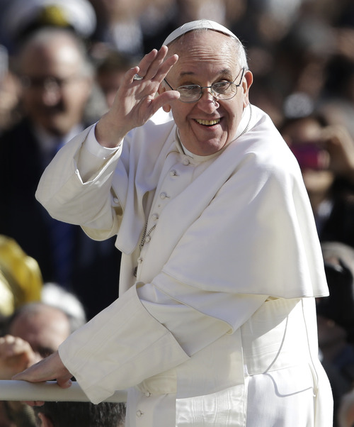 Pope Francis waves to crowds as he arrives to his inauguration Mass in St. Peter's Square at the Vatican, Tuesday, March 19, 2013. (AP Photo/Gregorio Borgia)