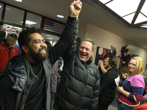 Keith Johnson | The Salt Lake Tribune  Brian Morris, right, and his new husband Noni Blake celebrate after they were married by Salt Lake City mayor Ralph Becker outside the Salt Lake County clerks office, Friday, December 20, 2013. A federal judge in Utah Friday struck down the state's ban on same-sex marriage, saying the law violates the U.S. Constitution's guarantees of equal protection and due process.