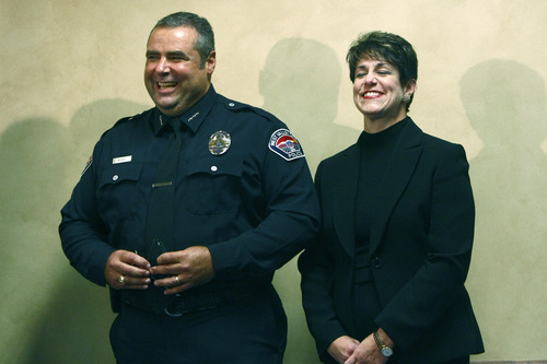 "Chris Detrick  |  The Salt Lake Tribune West Valley City Police Chief Lee Russo and his wife Susan laugh as Mayor Mike Winder talks during a press conference at West Valley City Hall Tuesday August 27, 2013. ""I saw this as an opportunity that I was well-matched for,"" Lee Russo said at a news conference announcing his selection."