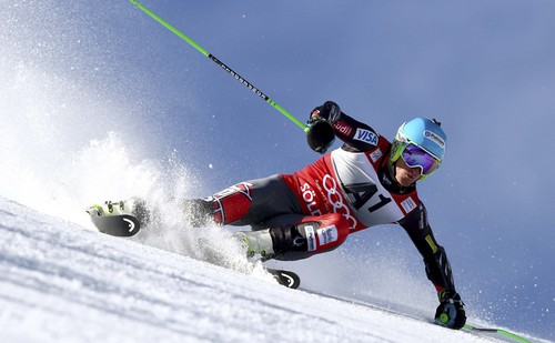 Ted Ligety, of the United States, speeds down the course during the first run of an alpine ski, men's World Cup giant slalom, in Soelden, Austria, Sunday, Oct. 27, 2013. (AP Photo/Alessandro Trovati)