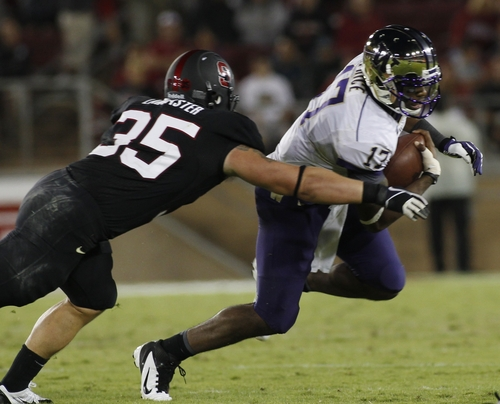 Washington quarterback Keith Price, right, is tackled by  Stanford's Jarek Lancaster during the second half of an NCAA college football game in Stanford, Calif., Saturday, Oct. 5, 2013. (AP Photo/George Nikitin)