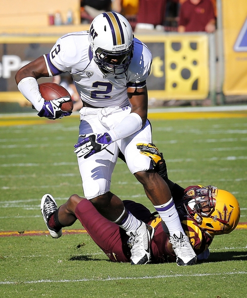Washington wide receiver Kasen Williams (2) is tackled by Arizona State defensive back Robert Nelson during the first half of an NCAA college football game, Saturday, Oct. 19, 2013, in Tempe, Ariz. (AP Photo/Matt York)