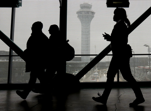 Passengers walk through inside Terminal 3 at O'Hare International Airport in Chicago on Friday, Dec. 20, 2013 .A survey of human resource managers found they encouraged employees to take all their vacation time because it leads to more productive workers. (AP Photo/Nam Y. Huh)