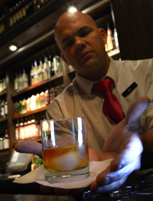 "Scott Sommerdorf   |  The Salt Lake Tribune Whiskey Street bartender ""M.J."" delivers High West American Prairie Reserve ""on the rocks."""
