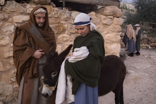 Actors playing Joseph and Mary walk with a donkey during a reenactment of the Nativity scene in the Israeli Arab town of Nazareth, Jesus's traditional hometown on Wednesday, Dec. 22, 2010. (AP Photo/Dan Balilty)