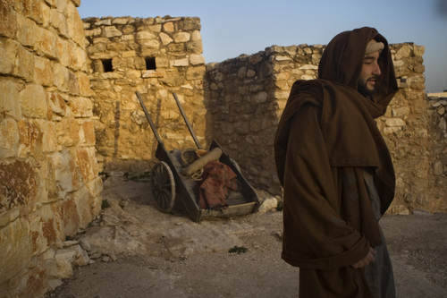 An actor playing Joseph looks on during a reenactment of the Nativity scene in the  Israeli Arab Town of Nazareth, Jesus's traditional hometown on Wednesday, Dec. 22, 2010. (AP Photo/Dan Balilty)