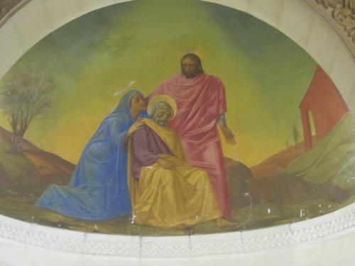 | Courtesy Eric Huntsman A painting in the Church of St. Joseph in Nazareth of an older Mary and an adult Jesus comforting an aged Joseph before his death.