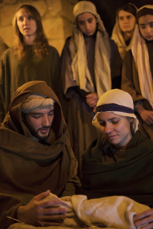 Actors playing Joseph and Mary, foreground, reenact the Nativity scene in the Israeli Arab town of Nazareth, Jesus's traditional hometown on Wednesday, Dec. 22, 2010. (AP Photo/Dan Balilty)