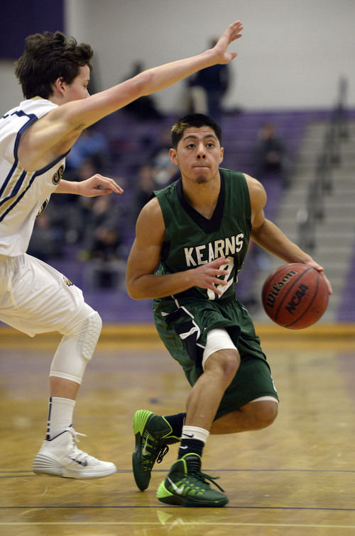 Francisco Kjolseth  |  The Salt Lake Tribune Alex Zepeda of Kearns looks for an open teammate against Skyline in the Riverton Holiday Tourney at Riverton High school on Friday, Dec. 27, 2013.