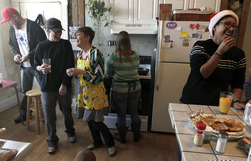 Leah Hogsten  |  The Salt Lake Tribune Newlyweds Pidge Winburn (left, in black) and Amy Fowler (right, in apron) share a laugh with friends l-r Mike Dray, Dayna McKee and L Villalva.  The two celebrated Christmas Day brunch with friends at their home. The two were married Monday, December 23. Wednesday, December 25th.