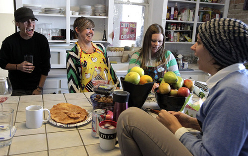 Leah Hogsten  |  The Salt Lake Tribune l-r Newlyweds Pidge Winburn and Amy Fowler celebrated Christmas Day brunch with friends Dayna McKee and Serina Gorst at their home. The two were married Monday, December 23. Wednesday, December 25th.