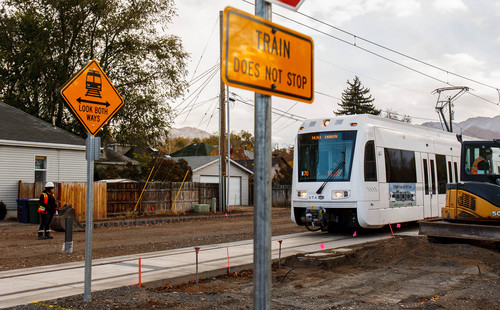 Trent Nelson  |   Tribune file photo A train tests the Sugar House Streetcar line in October 2013. Salt Lake City is seeking a federal grant to extend the line.