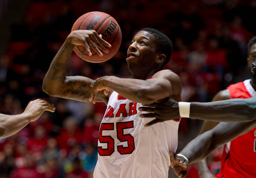 Trent Nelson  |  The Salt Lake Tribune Utahís Delon Wright (55) loses the ball in stiff defense as the University of Utah hosts Ball State, NCAA basketball Wednesday November 27, 2013 at the Huntsman Center in Salt Lake City.