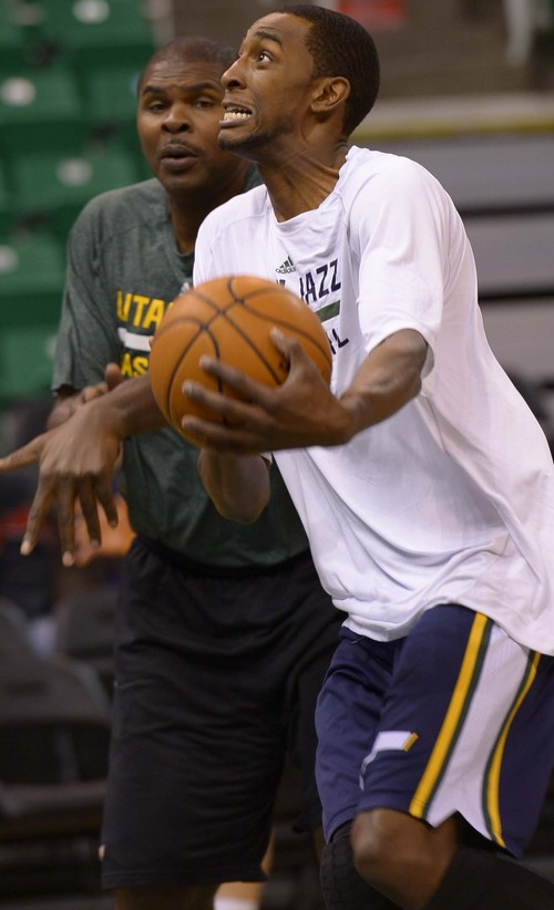 Leah Hogsten     The Salt Lake Tribune Utah Jazz small forward Jeremy Evans (40) warms up in a shoot around with assistant coach Michael Sanders prior to the matchup with the LA Lakers, Friday, December 27, 2013 at Energy Solutions Arena in Salt Lake City.