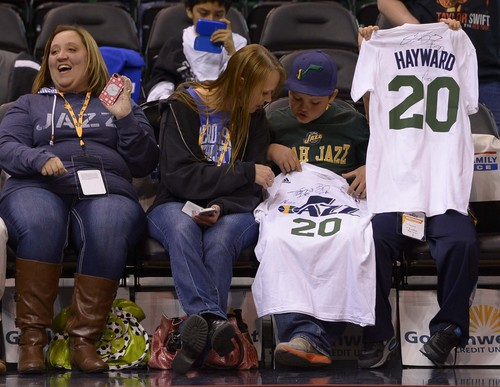 Leah Hogsten     The Salt Lake Tribune Utah Jazz fans wait to get autographs during player shoot around prior to the matchup with the LA Lakers, Friday, December 27, 2013 at Energy Solutions Arena in Salt Lake City.