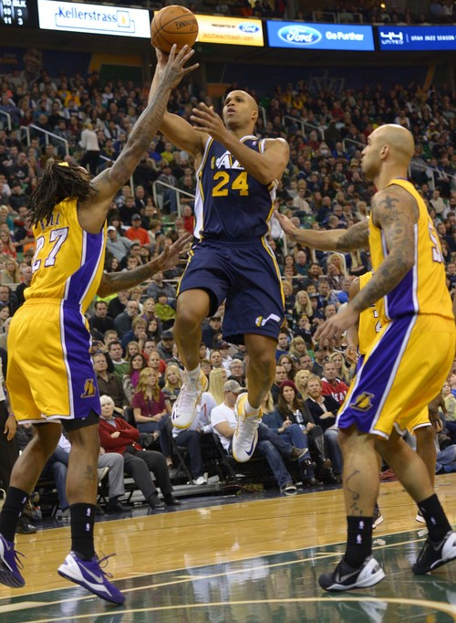 Leah Hogsten  |  The Salt Lake Tribune Utah Jazz small forward Richard Jefferson (24) drives over Los Angeles Lakers center Jordan Hill (27). The Utah Jazz defeated the LA Lakers 105-103, Friday, December 27, 2013 at Energy Solutions Arena in Salt Lake City.