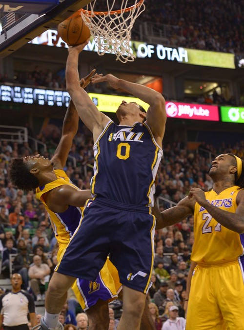 Leah Hogsten     The Salt Lake Tribune Utah Jazz center Enes Kanter (0) is fouled by Los Angeles Lakers small forward Nick Young (0). The Utah Jazz defeated the LA Lakers 105-103, Friday, December 27, 2013 at Energy Solutions Arena in Salt Lake City.