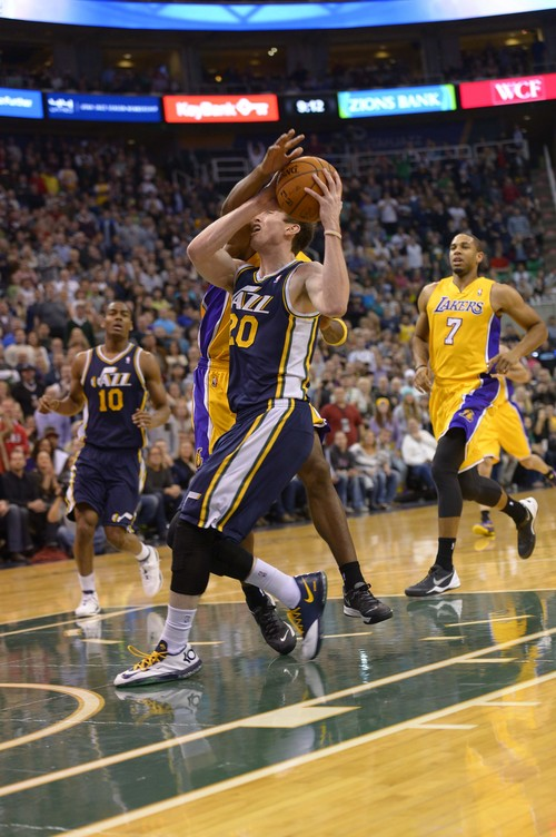 Leah Hogsten  |  The Salt Lake Tribune Utah Jazz shooting guard Gordon Hayward (20) is fouled by Los Angeles Lakers shooting guard Jodie Meeks (20). The Utah Jazz defeated the LA Lakers 105-103, Friday, December 27, 2013 at Energy Solutions Arena in Salt Lake City.
