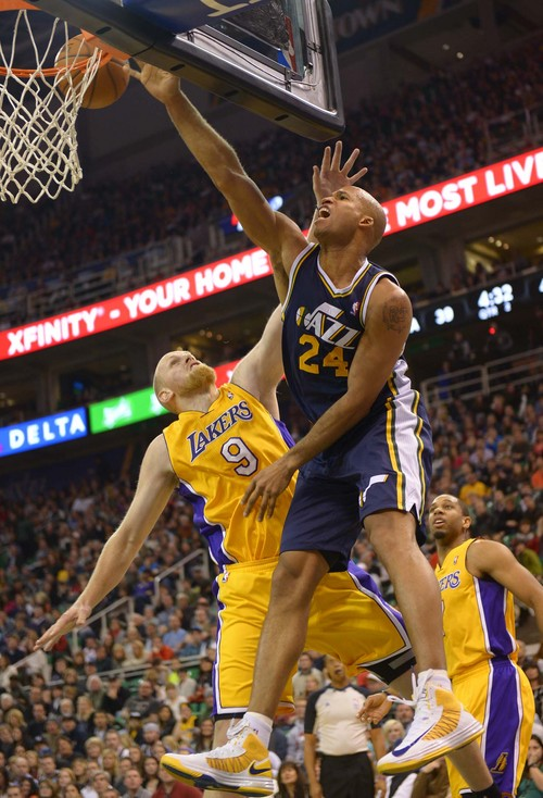 Leah Hogsten  |  The Salt Lake Tribune Utah Jazz small forward Richard Jefferson (24) drives to the net over Los Angeles Lakers center Chris Kaman (9). The Utah Jazz defeated the LA Lakers 105-103, Friday, December 27, 2013 at Energy Solutions Arena in Salt Lake City.