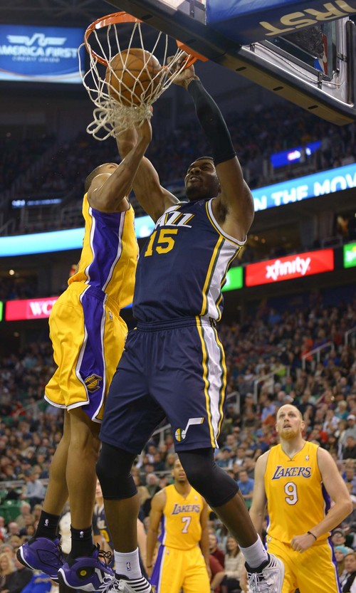 Leah Hogsten  |  The Salt Lake Tribune Utah Jazz power forward Derrick Favors (15) stuffs one over Los Angeles Lakers shooting guard Wesley Johnson (11).The Utah Jazz defeated the LA Lakers 105-103, Friday, December 27, 2013 at Energy Solutions Arena in Salt Lake City.
