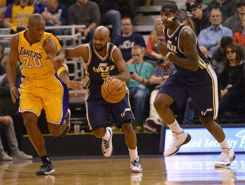 Leah Hogsten  |  The Salt Lake Tribune Utah Jazz point guard John Lucas III (5) steals from Los Angeles Lakers shooting guard Jodie Meeks (20). The Utah Jazz defeated the LA Lakers 105-103, Friday, December 27, 2013 at Energy Solutions Arena in Salt Lake City.