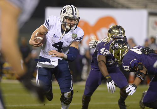 Scott Sommerdorf   |  The Salt Lake Tribune BYU QB Taysom Hill runs close to the goal line during first half play at the Fight Hunger Bowl at AT&T Park in San Francisco, Friday December 27, 2013.