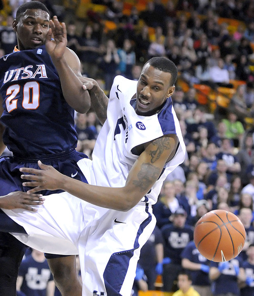 Texas-San Antonio forward Edrico McGregor (20) and Utah State center Jarred Shaw fight for a rebound during an NCAA college basketball game on Saturday, March 9, 2013, in Logan, Utah. (AP Photo/The Herald Journal, Eli Lucero)