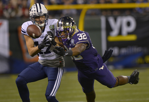 Scott Sommerdorf   |  The Salt Lake Tribune Washington Huskies DB Tre Watson (32) leaps to break up a pass intended for Brigham Young Cougars WR Skyler Ridley (17) that stalled BYU's first drive at the Fight Hunger Bowl at AT&T Park in San Francisco, Friday December 27, 2013.