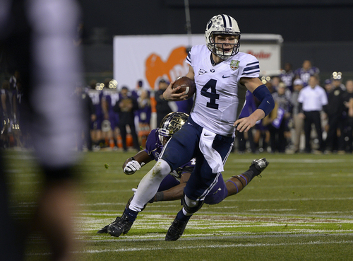 Scott Sommerdorf   |  The Salt Lake Tribune Brigham Young Cougars quarterback Taysom Hill (4) runs during first half play at the Fight Hunger Bowl at AT&T Park in San Francisco, Friday December 27, 2013.