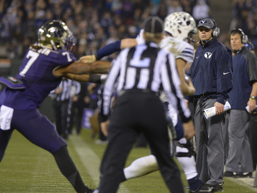 Scott Sommerdorf   |  The Salt Lake Tribune This late desperation play went out of bunds near head coach Bronco Mendenhall. Washington beat BYU 31-16 in the Fight Hunger Bowl at AT&T Park in San Francisco, Friday December 27, 2013.