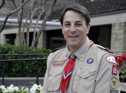 "Bill Helfand, the scoutmaster of Boy Scout Troop 55 in Houston, stands for a photo in Houston on Thursday, Dec. 19, 2013. In the wake of the Boy Scouts of America changing its policy to accept openly gay youths, Helfand said membership in his troop has remained steady at about 225 boys. ""We never considered sexual orientation, and I don't think many troops really did,"" he says. ""I don't know whether we had Scouts who are homosexual. I don't inquire ... It's not a matter of concern."" (AP Photo/Pat Sullivan)"
