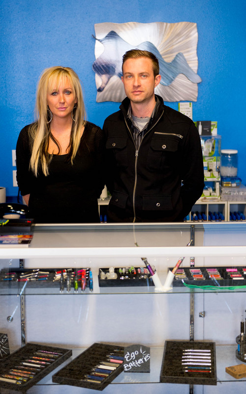 """Trent Nelson     The Salt Lake Tribune Jen Littlefield and Lewie Lambros are the ownders of Vapor Dreams in Bountiful. The city informed the owners of four electronic cigarette store through a Dec. 23 letter that their business licenses will not be renewed for calendar year 2014. The letter says the stores are considered a """"retail tobacco specialty business"""" and violate a state zoning law. The owners say they confirmed with the city that the locations were legal and that they now face financial hardship."""