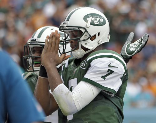 New York Jets quarterback Geno Smith (7) celebrates after his 7-yard touchdown run against the Miami Dolphins during the second quarter of an NFL football game Sunday, Dec. 29, 2013, in Miami Gardens, Fla. (AP Photo/Lynne Sladky)