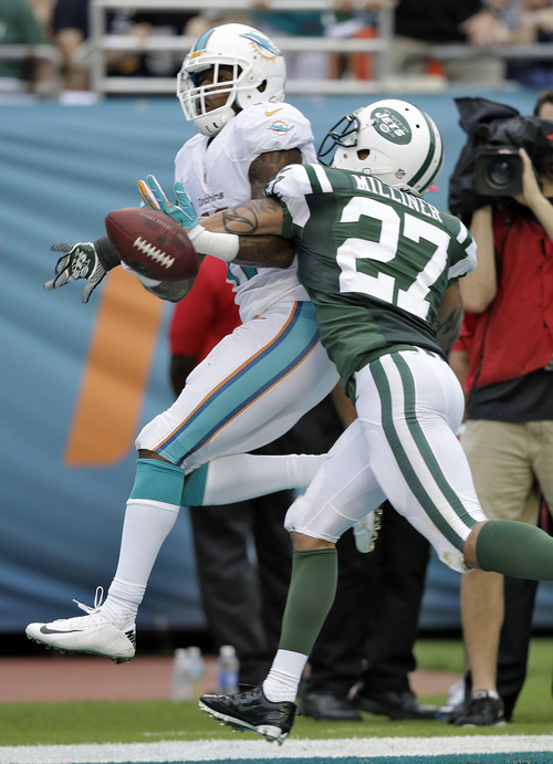 New York Jets cornerback Dee Milliner (27) breaks up a pass intended for Miami Dolphins wide receiver Mike Wallace (11) during the third quarter of an NFL football game Sunday, Dec. 29, 2013, in Miami Gardens, Fla. (AP Photo/Lynne Sladky)