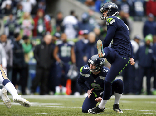 Seattle Seahawks kicker Steven Hauschka, right, follows through as his field goal is good against the St. Louis Rams in the first half of an NFL football game as Seahawks' Jon Ryan holds, Sunday, Dec. 29, 2013, in Seattle. (AP Photo/John Froschauer)