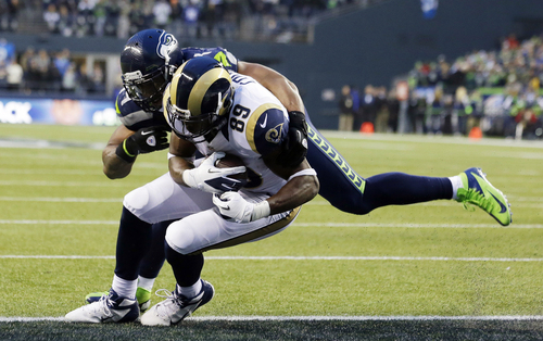 St. Louis Rams tight end Jared Cook (89) scores a touchdown as Seattle Seahawks middle linebacker Bobby Wagner tackles him in the second half of an NFL football game, Sunday, Dec. 29, 2013, in Seattle. (AP Photo/Elaine Thompson)