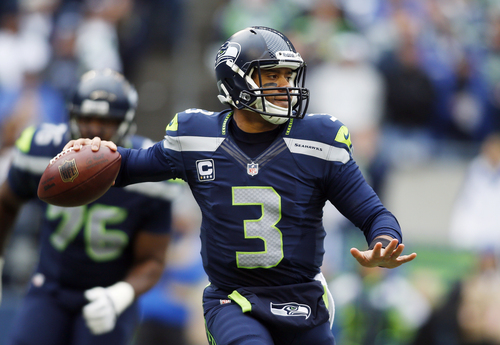 Seattle Seahawks quarterback Russell Wilson passes against the St. Louis Rams in the first half of an NFL football game, Sunday, Dec. 29, 2013, in Seattle. (AP Photo/John Froschauer)