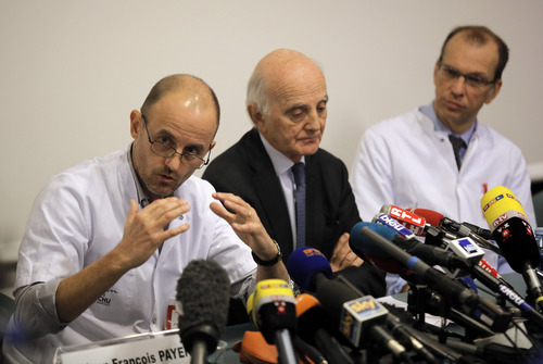 Professor Jean-Francois Payen, left, answers a journalist's question,  as Professor Gerard Saillant, center, and Professor Emmanuel Gay, right, look on, during a press conference at the Grenoble hospital, in the French Alps, where former seven-time Formula One champion Michael Schumacher is being treated after sustaining a head injury during a ski accident, in Genoble , France,  Monday, Dec. 30, 2013. Doctors say they cannot predict the outcome for Michael Schumacher, the retired Formula One driver who suffered a serious head injury in a ski accident. Chief anesthesiologist Jean-Francois Payen told reporters Monday that the seven-time champion is still in a medically induced coma. (AP Photo/Laurent Cipriani)