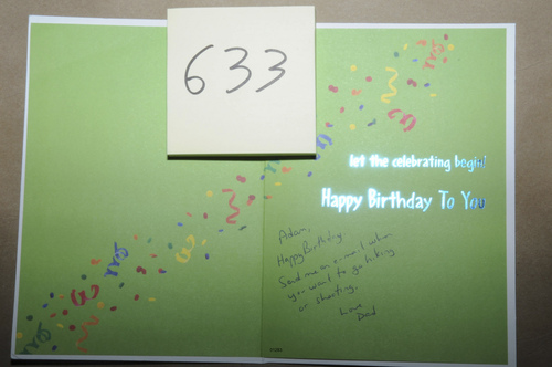 This evidence photo contained in a report of an investigation released by the Connecticut State Police Friday, Dec. 27, 2013, shows a birthday card to Adam Lanza from his father, found at the home where Adam Lanza lived with his mother in Newtown, Conn. Lanza gunned down 20 first-graders and six educators with a semi-automatic rifle at Sandy Hook Elementary School on Dec. 14, 2012, in Newtown, after killing his mother inside their home. Lanza committed suicide with a handgun as police arrived at the school. (AP Photo/Connecticut State Police)