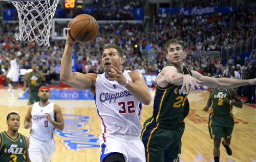 Los Angeles Clippers forward Blake Griffin, center, puts up a shot as Utah Jazz guard Gordon Hayward defends during the first half of an NBA basketball game, Saturday, Dec. 28, 2013, in Los Angeles. (AP Photo/Mark J. Terrill)