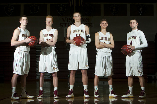 Chris Detrick  |  The Salt Lake Tribune Lone Peak's Talon Shumway, T.J. Haws, Eric Mika, Conner Toolson and Nick Emery pose for a portrait after a practice at Monday February 18, 2013.