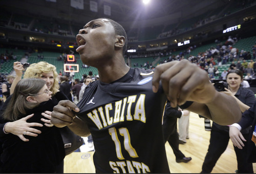 Wichita State's Cleanthony Early (11) celebrates after his team defeated Gonzaga 76-70 during a third-round game in the NCAA college basketball tournament in Salt Lake City Saturday, March 23, 2013. (AP Photo/Rick Bowmer)
