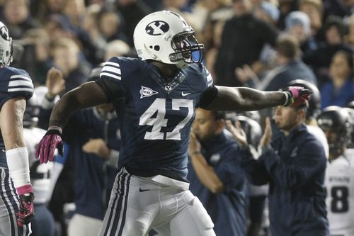 Chris Detrick  |  The Salt Lake Tribune Brigham Young Cougars linebacker Ezekiel Ansah (47) celebrates after making a tackle during the first half of the game at LaVell Edwards Stadium Friday October 5, 2012. BYU is winning the game 6-3.