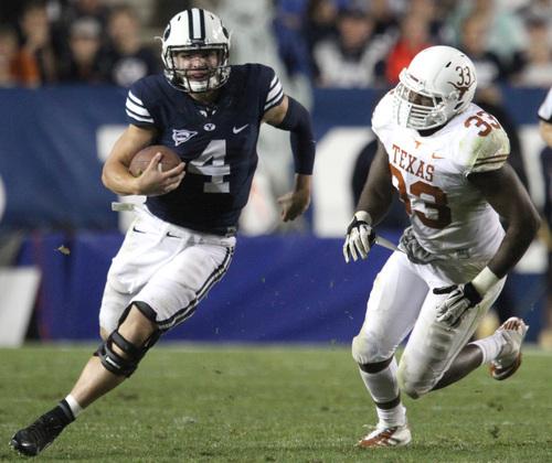 Rick Egan  | The Salt Lake Tribune    Brigham Young Cougars quarterback Taysom Hill (4) runs past  Longhorns linebacker Steve Edmond (33) in the Cougars 40-21 win over the University of Texas at Lavell Edwards stadium, Saturday, September 7, 2013.