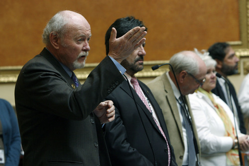 Francisco Kjolseth  |  Tribune file photo Rep.  Larry Wiley, D-West Valley City, is proposing legislation that would tighten rules for payday lenders. In this file photo, Wiley stands on the House floor to thank Veterans gathered at the Utah Capitol.