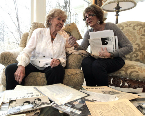 Leah Hogsten  |  The Salt Lake Tribune Claudia Frendt and her mother Oneida Lee Lange look at old photographs of their family, Friday, December 13, 2013. Family of scandalized former Rep. Douglas Stringfellow has made his unpublished autobiography available to the Tribune. He had confessed to lying about being a war hero, which was a major national scandal in 1954. His autobiography says he originally believed those stories himself.