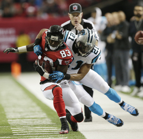 Atlanta Falcons wide receiver Harry Douglas (83) is hit by Carolina Panthers free safety Mike Mitchell (21) during the first half of an NFL football game, Sunday, Dec. 29, 2013, in Atlanta. (AP Photo/Dave Martin)
