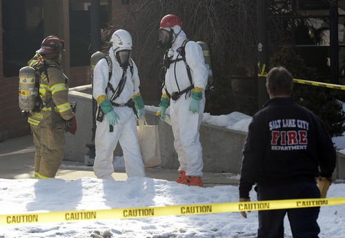 Al Hartmann  |  The Salt Lake Tribune Salt Lake City Fire Department and Hazardous Materials Response Team investigate a possible ricin letter sent to radio stations at Trolley Corners buiding at 700 East and 500 South Monday December 30.